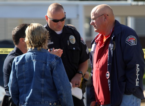 """Rick Egan    The Salt Lake Tribune   West Valley Police Chief Thayle """"Buzz"""" Nielsen talks to officers at the scene of a fatal shooting at the Lexington Park apartments in West Valley City, after a fatal shooting at the complex, Friday, November 2, 2012."""