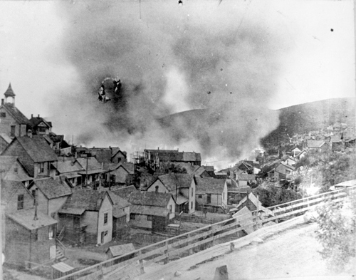 (Salt Lake Tribune Archive)  A photograph at daybreak of the Park City fire of 1898 burning through the center of town.