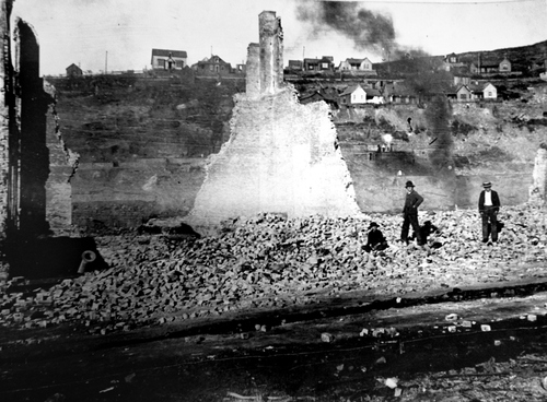 (Salt Lake Tribune Archive)  Children play in the ashes and rubble while Park City continues to smolder in the background following the fire of 1898.