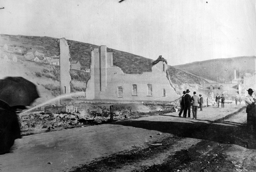 (Salt Lake Tribune Archive)  The charred walls of Park City's Grand Opera House stand gaunt and ragged above the rubble. The opera house was one of Park City's most imposing structures.