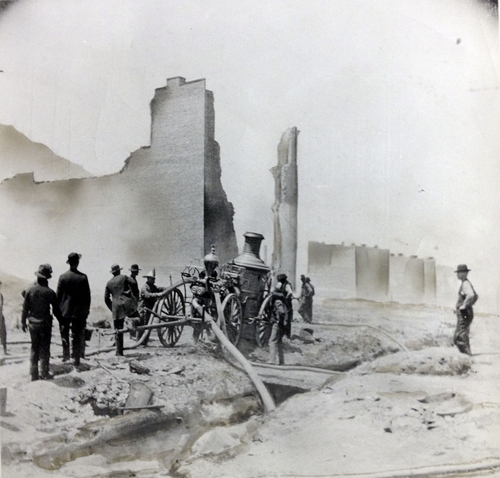 (Salt Lake Tribune Archive)  A fire engine company from Salt Lake battles flames in Park City's opera house during the devastating fire of 1898 in Park City.