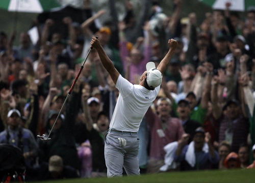 Adam Scott, of Australia, celebrates after making a birdie putt on the second playoff hole to win the Masters golf tournament Sunday, April 14, 2013, in Augusta, Ga. (AP Photo/Matt Slocum)