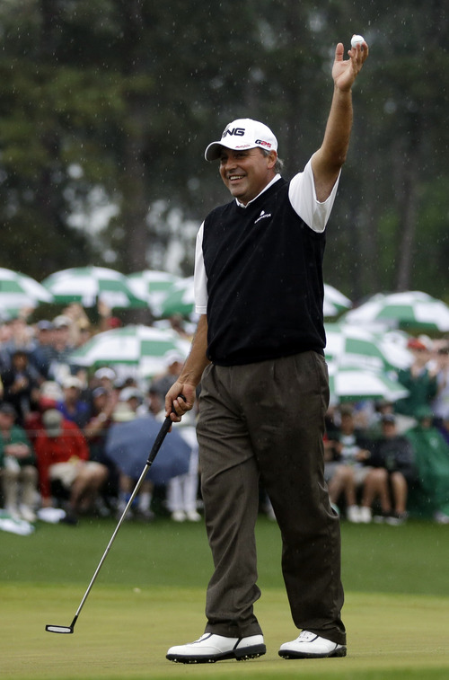Angel Cabrera, of Argentina, holds up his ball after birdie putt on the 18th hole during the fourth round of the Masters golf tournament Sunday, April 14, 2013, in Augusta, Ga.  (AP Photo/David J. Phillip)