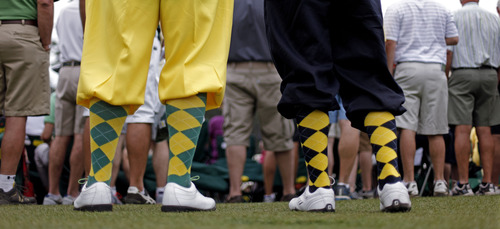 Richard Walker, left, and his son Billy, from Yorkshire, England, wear golf knickers as they watch the fourth round of the Masters golf tournament Sunday, April 14, 2013, in Augusta, Ga. (AP Photo/David Goldman)