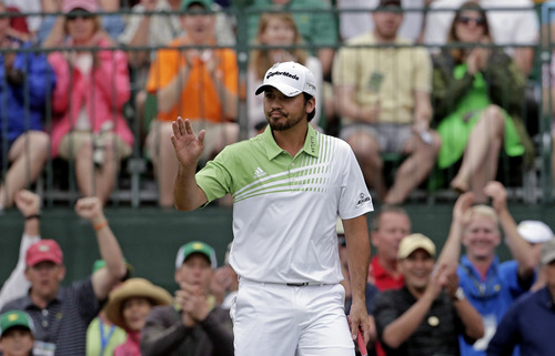 Jason Day, of Australia, acknowledges applause after a birdie putt on the first green during the fourth round of the Masters golf tournament Sunday, April 14, 2013, in Augusta, Ga. (AP Photo/Charlie Riedel)