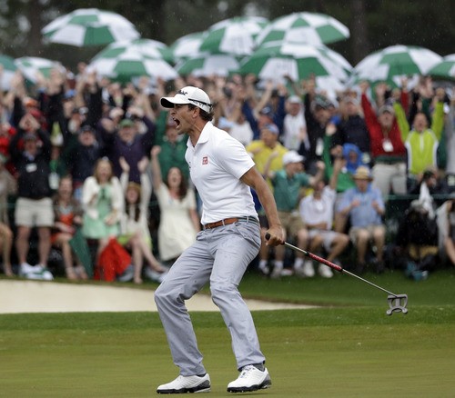 Adam Scott, of Australia, celebrates after a birdie putt on the 18th green during the fourth round of the Masters golf tournament Sunday, April 14, 2013, in Augusta, Ga. (AP Photo/David J. Phillip)
