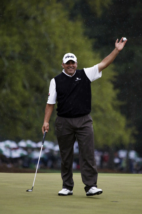 Angel Cabrera, of Argentina, holds up his ball after birdie putt on the 18th hole during the fourth round of the Masters golf tournament Sunday, April 14, 2013, in Augusta, Ga. (AP Photo/Darron Cummings)
