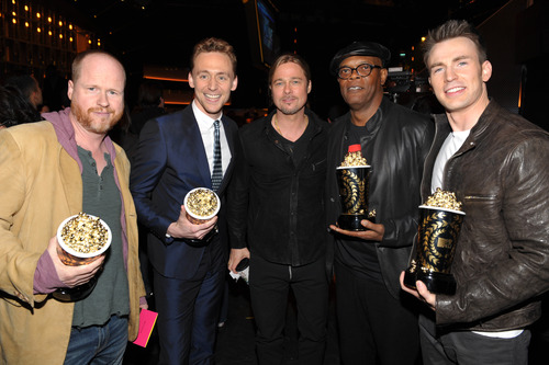 "IMAGE DISTRIBUTED FOR MTV - Actor Brad Pitt, center, and from left, director Joss Whedon, actors Tom Hiddleston, Samuel L. Jackson and Chris Evans, from the cast of ""The Avengers,"" winner of the award for movie of the year, pose backstage at the MTV Movie Awards in Sony Pictures Studio Lot in Culver City, Calif., on Sunday April 14, 2013. (Photo by John Shearer/Invision for MTV/AP Images)"