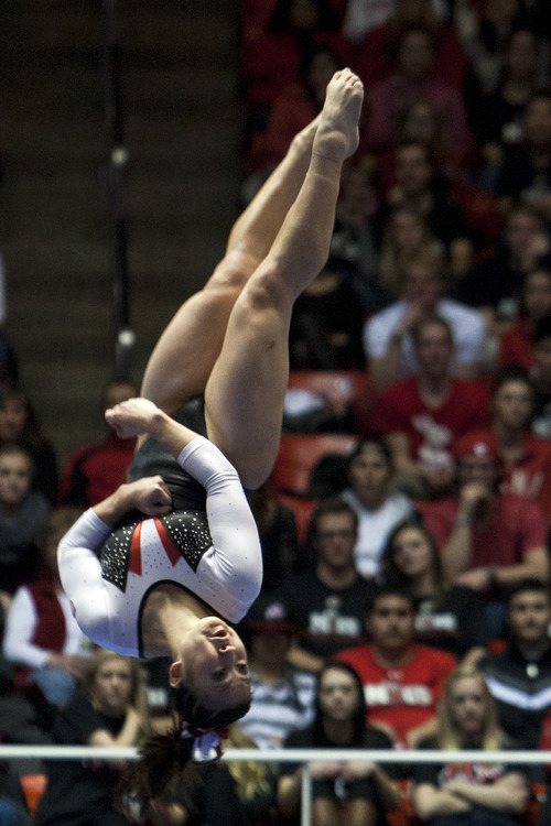 "Chris Detrick  |  The Salt Lake Tribune ""I've been lucky. I've never been a person who needed to take that much, but there were people who took a lot. Then, you just take what you think is going to help,"" says Corrie Lothrop, a Utah gymnast on athletes taking painkillers. Here, she competes on the beam during a meet in 2013."