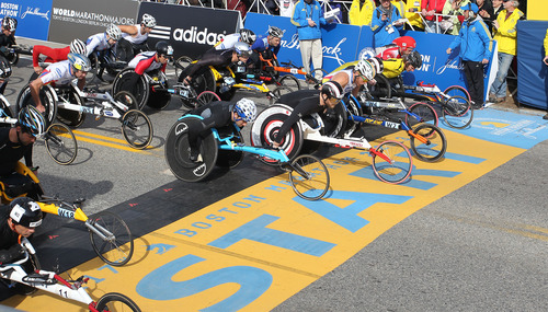 Defending champion Joshua Cassidy, of Canada, fifth front right, starts the wheelchair division of the 117th running of the Boston Marathon, in Hopkinton, Mass., Monday, April 15, 2013. (AP Photo/Stew Milne)