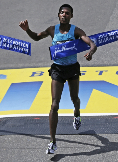 Lelisa Desisa, of Ethiopia, breaks the finish line tape to win the 2013 running of the Boston Marathon in Boston, Monday, April 15, 2013. (AP Photo/Charles Krupa)