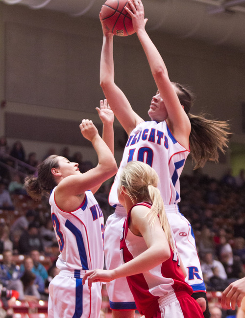 Richfield Wildcat Megan Bean shoots the ball over the Kanab Cowboy defense during the 2A State Tournament.