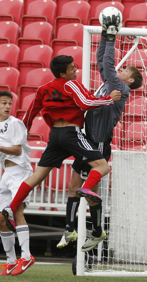Rick Egan    The Salt Lake Tribune   Alta goal keeper, Brandon Arnold Jordan, saves the ball, as Alta's Tanner Valerio (18) collides with him, in soccer action in the title game of the Rio Cup boys' soccer game Jordan vs. Alta,  at Rio Tinto Stadium, Saturday, April 13, 2013.