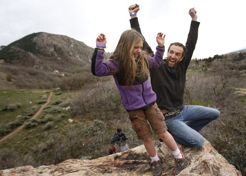 Leah Hogsten     The Salt Lake Tribune Shane Bryson and Aubriana Turner, 8, celebrates atop the boulder Turner climbed for the first time April 12, 2013 at the 6th Annual Ogden Climbing Festival sponsored by Weber State University Campus Recreation Outdoor Program. Newcomers to the sport of climbing played around the boulder field in Ogden during the state's largest climbing festival.