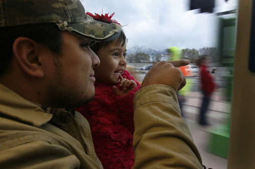 Scott Sommerdorf      The Salt Lake Tribune Three year old Neyza Navarette takes her first train ride in the lap opf her father, Luis as they take the TRAX train down North Temple as it makes it's  way down North Temple, Saturday, April 13, 2013.