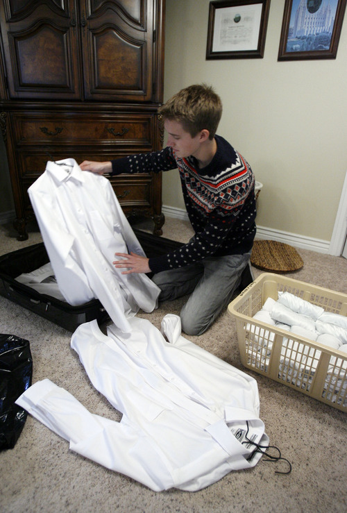 Francisco Kjolseth     The Salt Lake Tribune Brennan Rasmussen, 18, of Provo packs his things on Tuesday, April 9, 2013, as he gets ready to leave for the MTC on Wednesday and then off to Baltimore for his mission. Rasmussen graduated from Timpview High early in order to go on his mission when he turned 18.