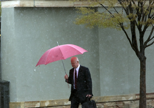 Kim Raff  |  The Salt Lake Tribune Fred Nichols walks through Temple Square on his way to work as a wintry mix falls in Salt Lake City on Monday, April 15, 2013.