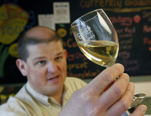 Al Hartmann  |  The Salt Lake Tribune Jay Yahne checks the color and quality of an apricot-pineapple wine nearly ready at the wine tasting station at the Hive Winery in Layton.   He makes 30 kinds of wine.   The Hive Winery is one of six Utah wineries which are facing hurdles put up by state lawmakers that make it difficult for them to do business.