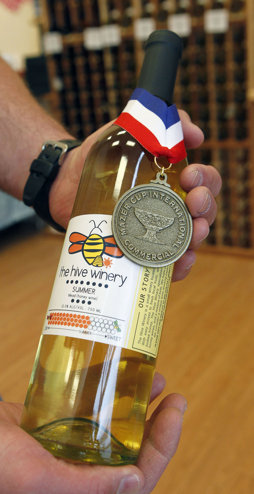Al Hartmann     The Salt Lake Tribune Jay Jayne holds a bottle of award winning Summer Mead (honey wine.)  The wines are starting to win national and international medals in their class despite only being in business for two years.  The Hive Winery is one of six Utah wineries which are facing hurdles put up by state lawmakers that make it difficult for them to do business.
