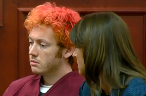 In this image taken from video provided by KUSA.com, James Holmes, left, the suspected gunman in Friday's Colorado theater massacre, makes his first appearance in court with his attorney Tamara Brady in Centennial, Colo. on Monday, July 23, 2012. (AP Photo/KUSA.com)