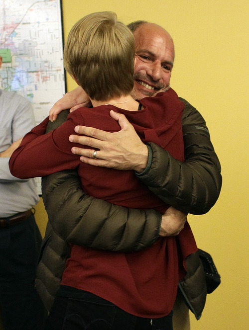 Denver Post staff photographer Craig Walker, facing, hugs colleague breaking news reporter Jordan Steffen, after the announcement that The Denver Post Staff had won a Pulitzer Prize for Breaking News, inside the newsroom of the Denver Post, in Denver, Monday April 15, 2013. The Post won for their comprehensive coverage of the shooting massacre at an Aurora, Colorado movie theatre in July 2012. (AP Photo/Brennan Linsley)
