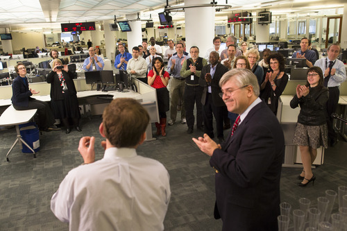 Members of the Associated Press Headquarters newsroom applaud the announcement of the 2013 Pulitzer Prize winners, Monday, April 15, 2013, in New York. Associated Press photographers Rodrigo Abd, Manu Brabo, Narciso Contreras, Khalil Hamra, and Muhammed Muheisen won the 2013 Pulitzer Prize for Breaking News Photography for their work covering the Syrian civil war. (AP Photo/John Minchillo)