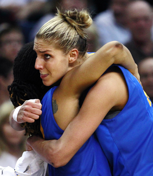 Delaware forward Elena Delle Donne, right, is embraced by Trumae Lucas in the final seconds of a regional semifinal in the NCAA college basketball tournament in Bridgeport, Conn., Saturday, March 30, 2013. Delle Donne scored 33 points, but Kentucky won 69-62. (AP Photo/Charles Krupa)