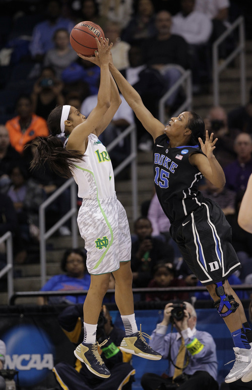Duke forward Richa Jackson (15) blocks a shot by Notre Dame guard Skylar Diggins during the first half of the regional final game of the NCAA women's college basketball tournament Tuesday, April 2, 2013, in Norfolk, Va. (AP Photo/Steve Helber)