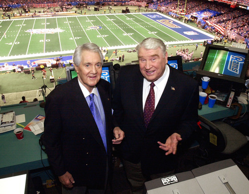 FILE - In this Feb. 3, 2002, file photo, Fox broadcasters Pat Summerall, left, and John Madden stand in the booth at Louisiana Superdome before the NFL Super Bowl XXXVI football game in New Orleans. Fox Sports spokesman Dan Bell said Tuesday, April 16, 2013, that Summerall, the NFL player-turned-broadcaster whose deep, resonant voice called games for more than 40 years, has died at the age of 82. (AP Photo/Ric Feld, File)