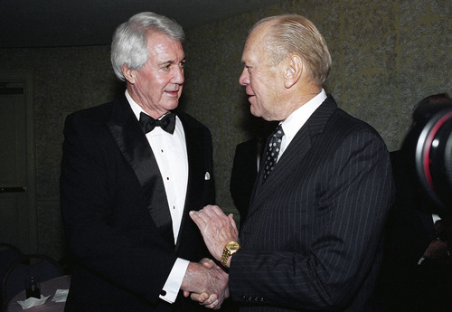 FILE - In this Nov. 30, 1994, file photo, former President Gerald Ford, right, greets sportscaster Pat Summerall at a reception for the 10th annual American Sportscasters Hall of Fame Awards dinner in New York. Ford presented Summerall with the Sportscaster of the Year award at the dinner honoring the legendary voices of sports broadcasting and the achievements of sports legends. Fox Sports spokesman Dan Bell said Tuesday, April 16, 2013, that Summerall, the NFL player-turned-broadcaster whose deep, resonant voice called games for more than 40 years, has died at the age of 82. (AP Photo/Ron Frehm, File)