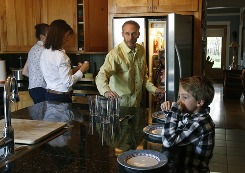 Scott Sommerdorf   |  The Salt Lake Tribune Stepfather Paul Lee helps prepare dinner with his wife Merrie Campbell-Lee, second from left, 16 year old Izzy, left, and one of his two sons, Finn, 7, at right, Friday, April 12, 2013.