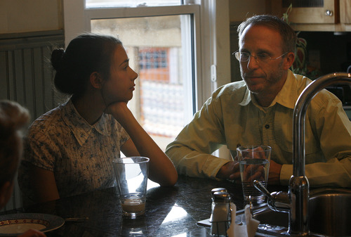 Scott Sommerdorf   |  The Salt Lake Tribune Paul Lee has been stepfather to 16-year-old Izzy Peterson since she was 5. Paul is married to Merrie Campbell-Lee and they have two young sons, Sullivan 9, and Finn 7, together. They have dinner together, Friday, April 12, 2013.