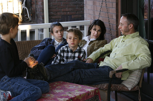 Scott Sommerdorf   |  The Salt Lake Tribune Stepfather Paul Lee hangs out with his family on the porch of their home after dinner, Friday, April 12, 2013. Left to right is; Sullivan, 9, Izzy, 16, Merrie Campbell-Lee and Paul Lee.