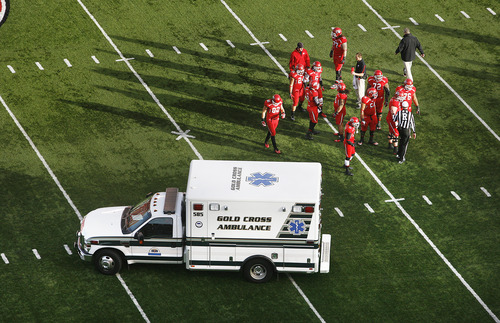Scott Sommerdorf  |  The Salt Lake Tribune              Utah players watch as an ambulance carrying team mate OL Sam Brenner leaves the field after the beginning of the second half. Colorado held a 10-0 lead over Utah at the half, Friday, November 25, 2011.