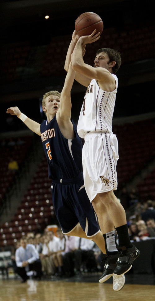 Trent Nelson  |  The Salt Lake Tribune Lone Peak's Nick Emery shoots a three-pointer, defended by Brighton's Zach Wertz. Brighton vs. Lone Peak, 5A high school state championship game Saturday, March 3, 2012 at the Maverik Center in West Valley City, Utah.