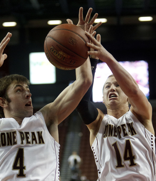 Trent Nelson  |  The Salt Lake Tribune Lone Peak's Nick Emery and Brody Berry reach for a rebound. Brighton vs. Lone Peak, 5A high school state championship game Saturday, March 3, 2012 at the Maverik Center in West Valley City, Utah.