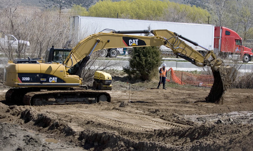 Paul Fraughton  |  The Salt Lake Tribune As traffic passes by on I-15 at Willard Bay State Park on Wednesday, April 10, 2013, heavy equipment works in the area where diesel fuel from a Chevron pipeline was spilled on March 18.