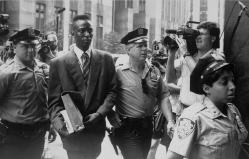 Yusef Salaam walks into court flanked by police and press. Courtesy of Daily News/Getty Images