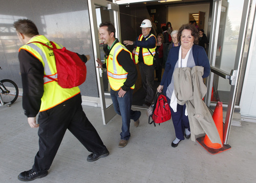 Al Hartmann  |  The Salt Lake Tribune Employees with the State of Utah with their 72 hour backpack kits exit the state office building during the Great Utah Shake Out, an earthquake simulation excercise at the Utah State Capitol Wednesday April 17.