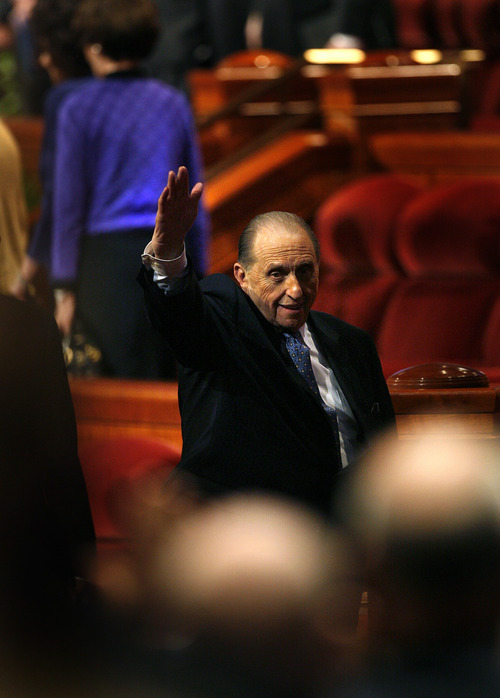 Scott Sommerdorf   |  The Salt Lake Tribune LDS President Thomas S. Monson waves to the audience as he leaves the stage after speaking to end the morning session of the second day of the 183rd LDS General Conference, Sunday, April 7, 2013.