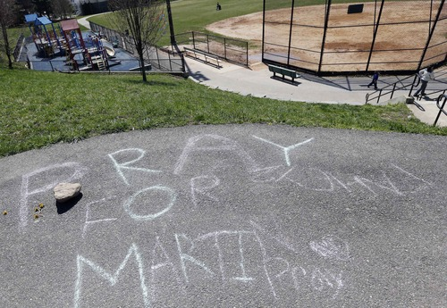 """Pray for Martin"" is written in chalk at a park near the home of Martin Richard in the Dorchester neighborhood of Boston,Tuesday, April 16, 2013. 8-year old Martin was killed in the bombing at the finish line of the Boston Marathon on Monday. (AP Photo/Michael Dwyer)"
