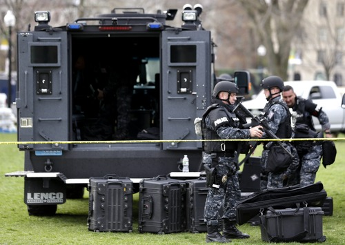 Officials suit up in tactical gear at Boston Common, Tuesday, April 16, 2013, one day after bombs exploded at the finish line of the Boston Marathon. The twin explosions near the marathon's finish line killed three people, wounded more than 170 and reawakened fears of terrorism. (AP Photo/Julio Cortez)