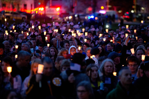 Mourners attend candlelight vigil for Martin Richard at Garvey Park, near Richard's home in the Dorchester section of Boston, on Tuesday, April 16, 2013. Martin is the 8-year-old boy killed in the Boston Marathon bombing. (AP Photo/The New York Times, Josh Haner)  MANDATORY CREDIT;  NYC OUT;  MAGS OUT; NO SALES; TV OUT,  NO ARCHIVE