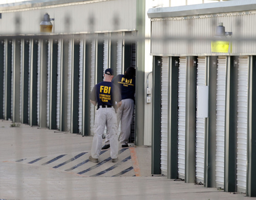 "Authorities search a storage unit at Gibson Self Storage as they continue to investigate the slayings of Kaufman County District Attorney Mike McLelland, his wife and a top prosecutor, Saturday, April 13, 2013 in Seagoville, Texas. Authorities investigating the death of a Texas district attorney arrested Eric Williams, a former justice of the peace and charged him Saturday with making a ""terroristic threat"" after searching his home. (AP Photo/The Dallas Morning News, Michael Ainsworth)"
