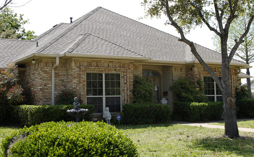 File - In this April 15, 2013 file photo, the home of Eric Lyle Williams is shown in Kaufman, Texas. Texas authorities have arrested the former justice of the peace's wife, Kim Lene Williams. Online jail records do not list charges against her and officials in Kaufman County wouldn't immediately comment on the reason for her arrest. A law enforcement official has said authorities are trying to build a case against Eric Lyle Williams in the deaths of Kaufman County District Attorney Mike McLelland and his wife, Cynthia. (AP Photo/Tony Gutierrez, File)
