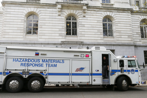 A Capitol Police Hazardous Materials Response Team truck is parked at the Russell Senate Office building on Capitol Hill in Washington, Wednesday, April 17, 2013, after reports of suspicious packages discovered on Capitol Hill. U.S. Capitol police are investigating the discovery of at least two suspicious envelopes in Senate office buildings across the street from the Capitol.  (AP Photo/Charles Dharapak)