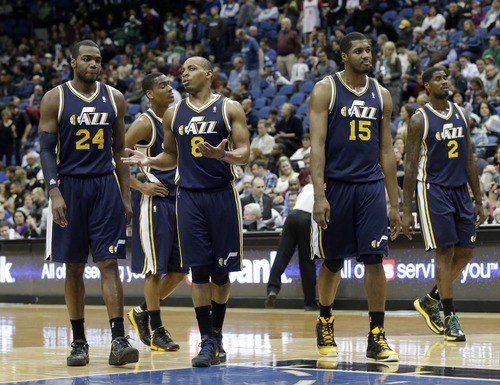 Utah Jazz's Paul Millsap (24), Randy Foye (8), Derrick Favors  (15) and Marvin Williams are shown in the second half of an NBA basketball game against the Minnesota Timberwolves Monday, April 15, 2013 in Minneapolis. The Jazz won 96-80. (AP Photo/Jim Mone)