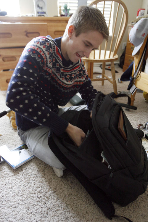 Francisco Kjolseth  |  The Salt Lake Tribune Brennan Rasmussen, 18, of Provo packs his things on Tuesday, April 9, 2013, as he gets ready to leave for the MTC on Wednesday, and then off to Baltimore for his mission. Rasmussen graduated from Timpview High early in order to go on his mission when he turned 18.
