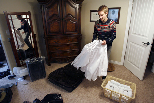 Francisco Kjolseth  |  The Salt Lake Tribune Brennan Rasmussen, 18, of Provo packs his things on Tuesday, April 9, 2013, as he gets ready to leave for the MTC on Wednesday and then off to Baltimore for his mission. Rasmussen graduated from Timpview High early in order to go on his mission when he turned 18.