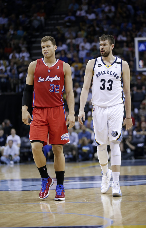 Los Angeles Clippers forward Blake Griffin (32) and Memphis Grizzlies center Marc Gasol (33), of Spain, walk down the court in the second half of an NBA basketball game on Saturday, April 13, 2013, in Memphis, Tenn. The Clippers won 91-87. (AP Photo/Mark Humphrey)